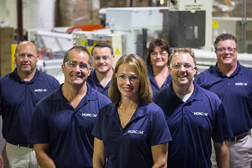 Morcon manufacturing employees posing for a photo.